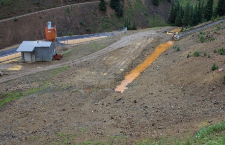 Discharge from the American Tunnel at Gladstone. This water is not treated before running into Cement Creek.