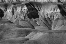 """Badlands near Georgia O'Keefe's """"Black Place,"""" surrounded by oil development."""