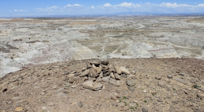 A possible Chaco-era shrine atop a mound above Kutz Canyon, at what may be the northern terminus of the Great North Road. The La Plata Mountains can be seen in the distance.
